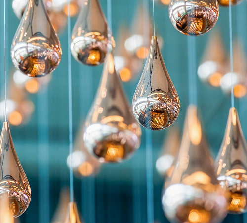 Modern metallic Christmas orbs-Restaurant Decorating Ideas for the Holiday Season