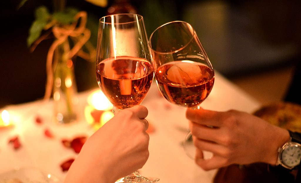 Couple Toasting at Restaurant-Valentines Day Promotion Ideas for Your Restaurant