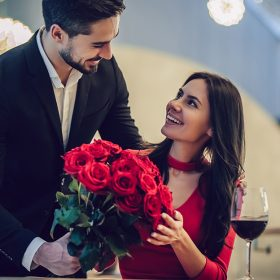 Male Giving Roses to His Date-Valentines Day Promotion Ideas for Your Restaurant