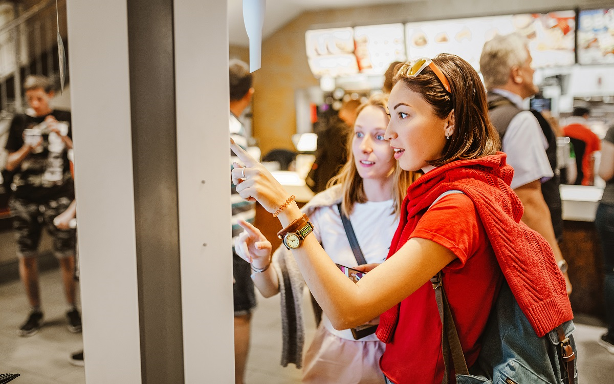 Women ordering at a fast food kiosk-Fast Food Trends for 2020