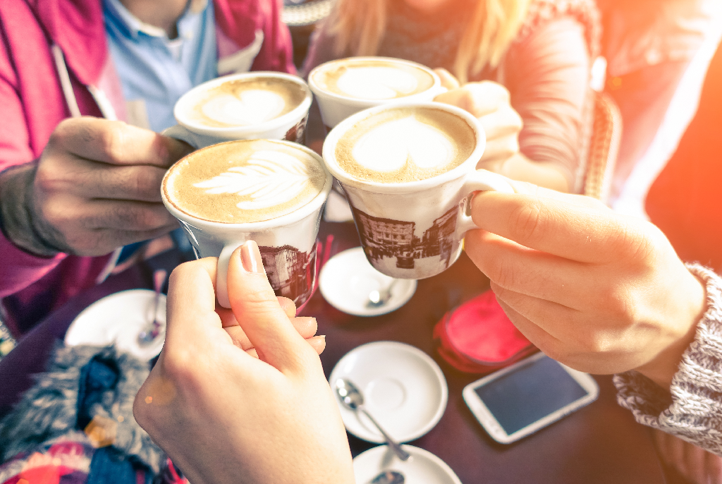Hands Holding Cappuccino Cups-How to Keep Your Restaurant Busy During Winter
