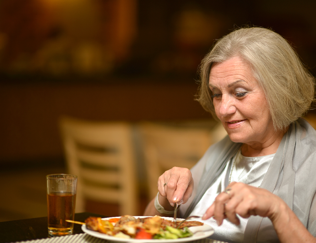 Elderly Woman Eating Meal-Senior Living Dining Ideas for Safety and Comfort