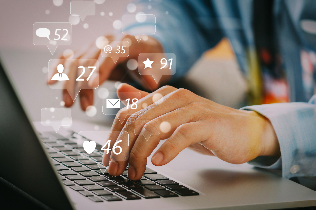 Person Typing on Laptop with Social Media Icons-5 Facebook and Instagram Advertising Tips for Your Restaurant