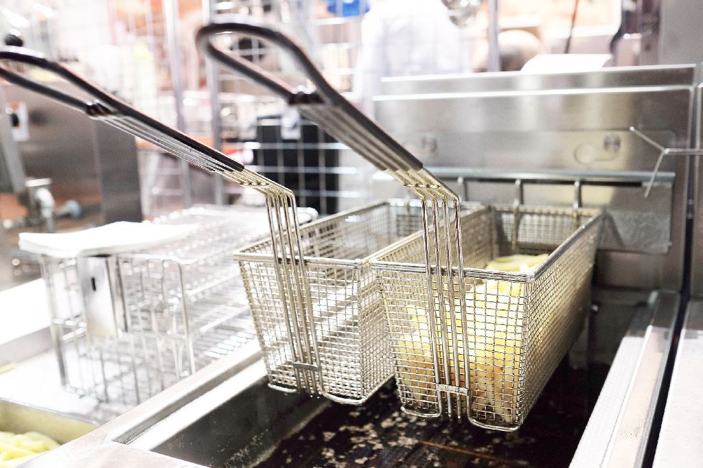 Fryer Baskets Above Fryer-Anets Deep Fryer Cleaning
