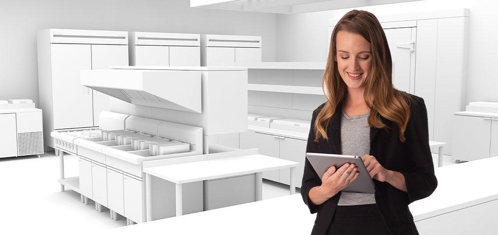 Person Holding Tablet in Commercial Kitchen-Using Technology To Transform Your Restaurant Operation