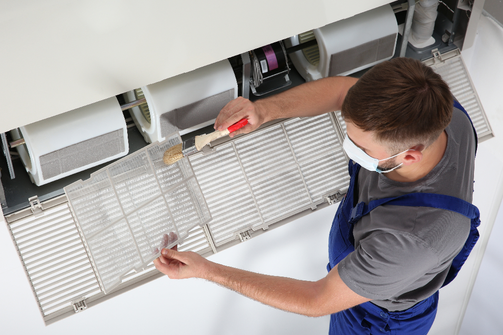 Repair Technician Replacing Air Filter—When to Change Commercial Air and Water Filters in Your Foodservice Facility