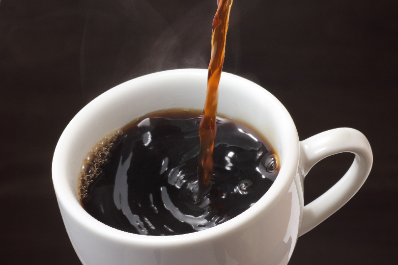 Coffee Pouring into White Coffee Cup—How to Use a Bloomfield Coffee Maker